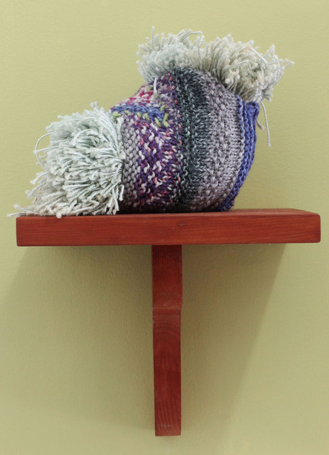 "Mollie Murphy How to Make a Severed-Hand Party Tray (sculpture) knitted and stuffed object, wooden shelf, Benjamin Moore's ""Pale Avocado"""