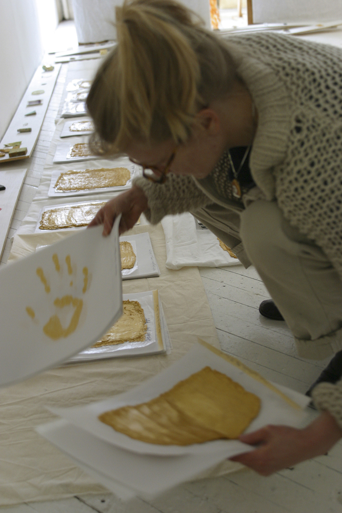 Gold Handprint Project Looking through Handprints in my studio