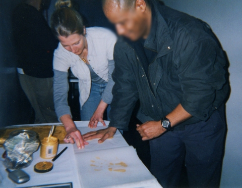 Gold Handprint Project Gathering Handprints NYC—Spring 2003