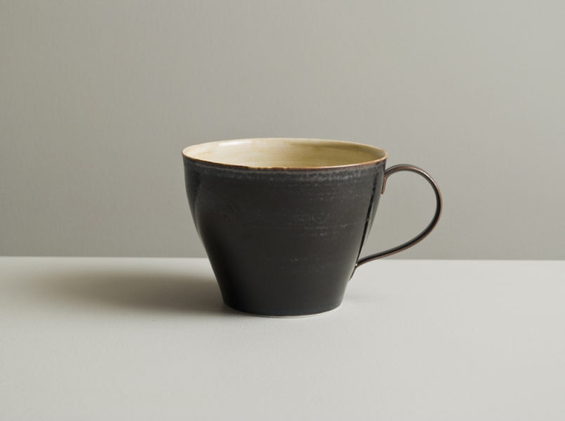 2011 Taut cup in watery ivory-green and variegated black glazes