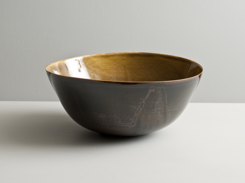 2011 Large undulating bowl in watery amber and variegated–brown-black glazes