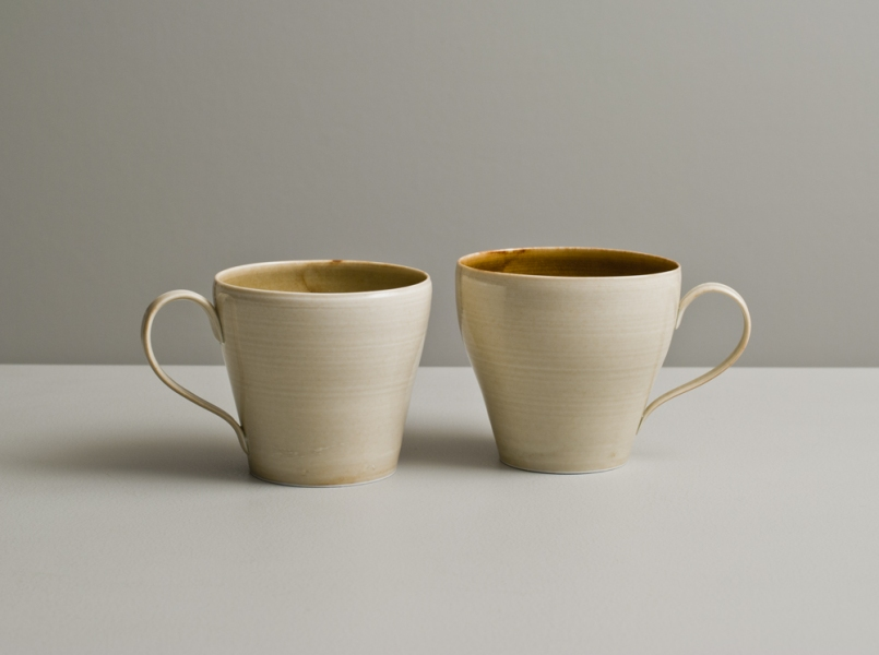 2012 Two cups in watery amber and ivory glazes