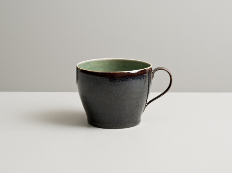 2012 Large cup in mottled-green and speckled brown-black glazes
