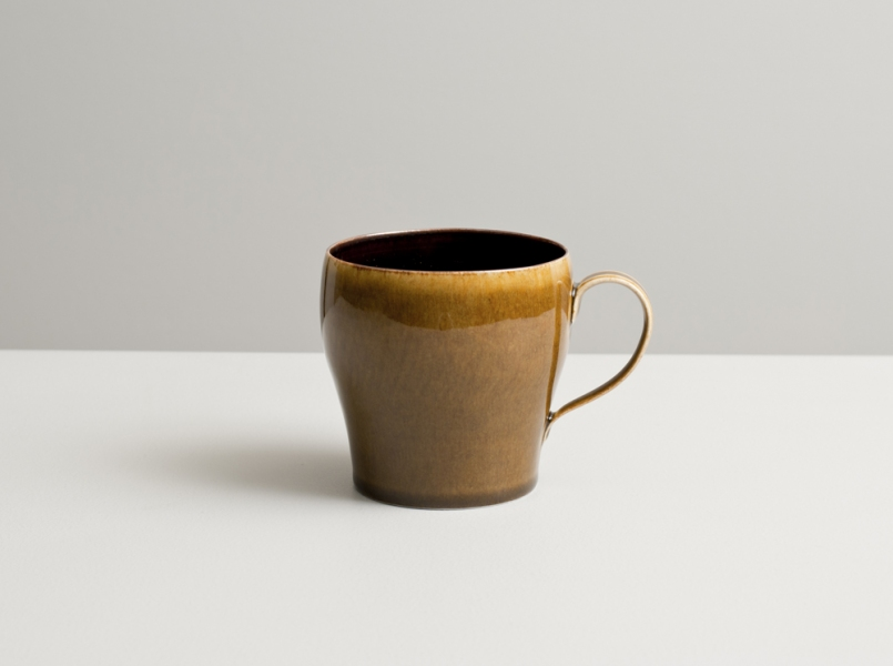2012 Cup in speckled-black and deep-amber glazes