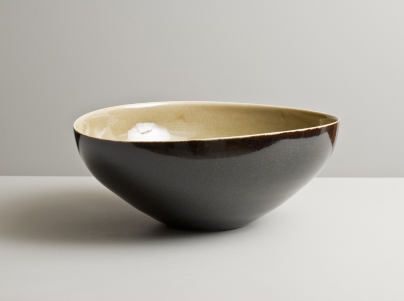 2012 Large undulating bowl in watery golden and speckled-black glazes