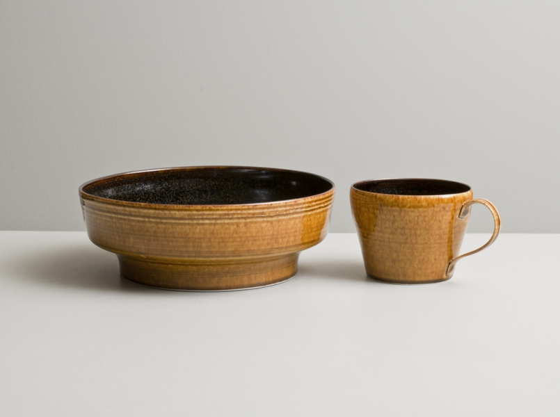 2012 Low stepped bowl and cup in speckled-black and mottled-amber glazes