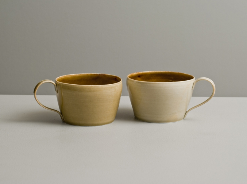 2012 Two low cups in watery amber, golden, and ivory glazes