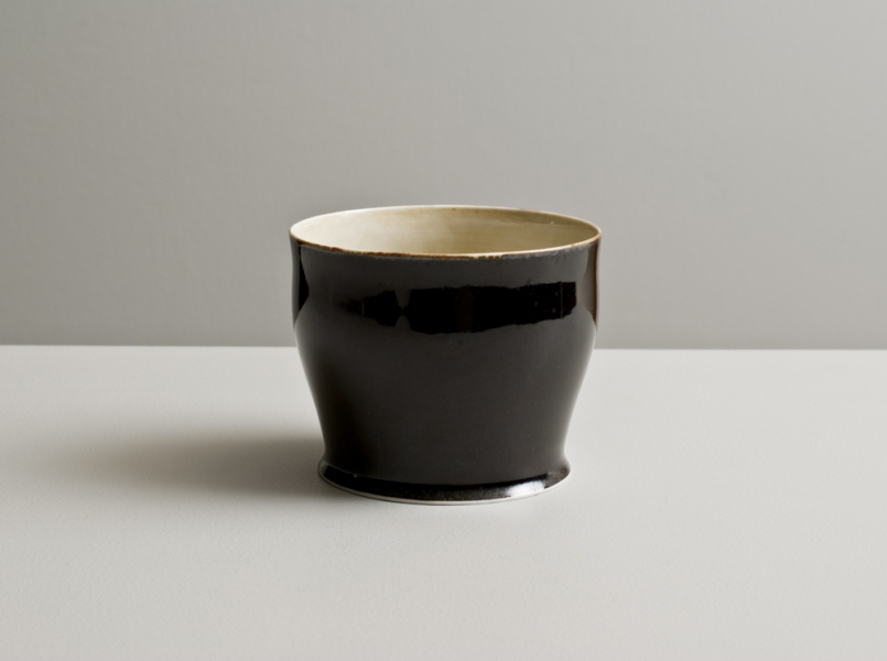 2012 Large cup in ivory-green and mirror-black glazes