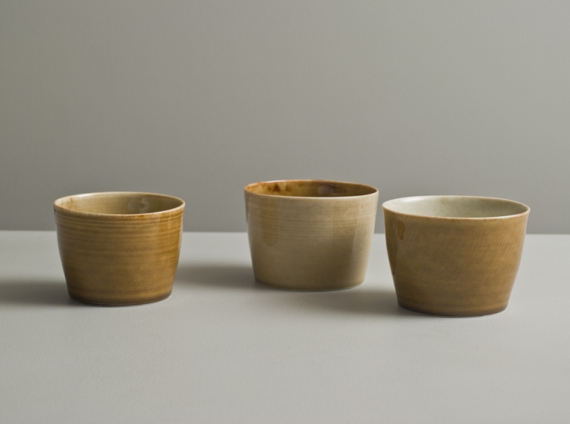 2011 Three cups in watery amber, golden, and stony ivory glazes