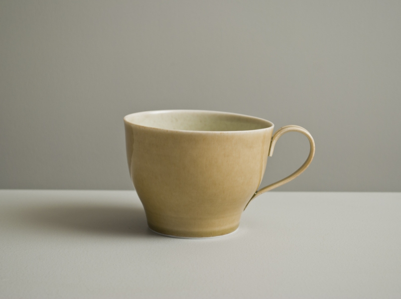 2011 Lilting cup in stony ivory and watery golden glazes