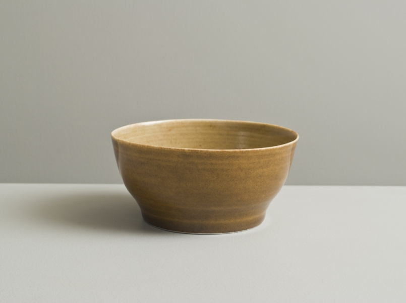 2011 Small thin bowl in stony ochre and deep amber glazes