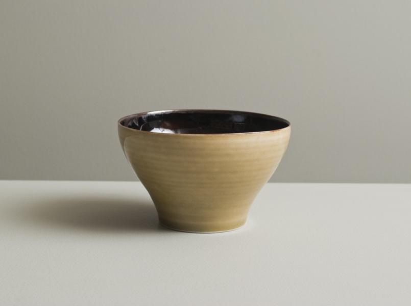 2011 Small cup in speckled-black and watery golden glazes