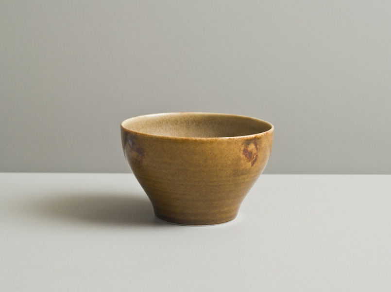 2011 Small fingerprinted cup in stony ochre and amber glazes
