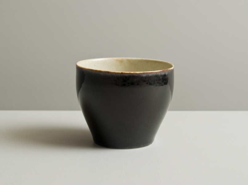 2011 Large cup in stony ivory and mirror-black glazes