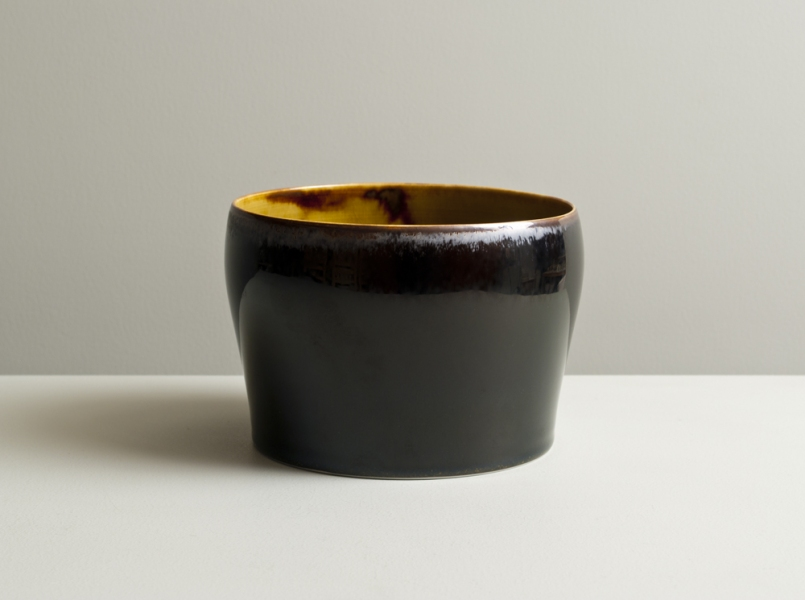 2011 Upright form in running-amber and mirror-black glazes