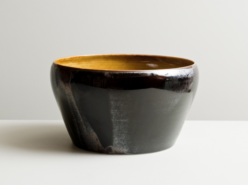 2011 Large upright form with inverted lip in running amber and variegated-black glazes