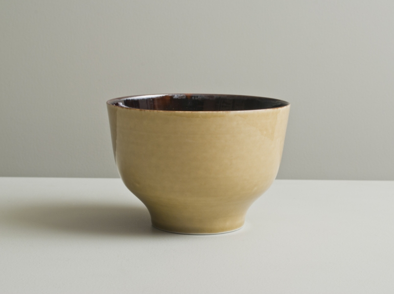 2011 Upright footed bowl in running violet-black and watery golden glazes