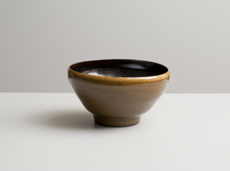 2012 Lilting bowl in speckled-black and deep-amber glazes