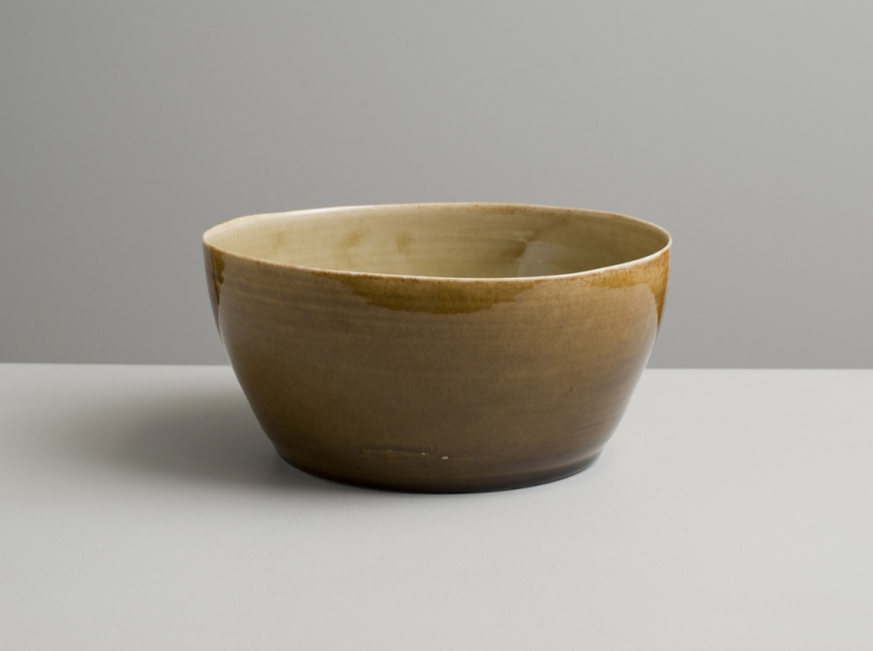 2012 Wavering bowl in watery golden and amber glazes