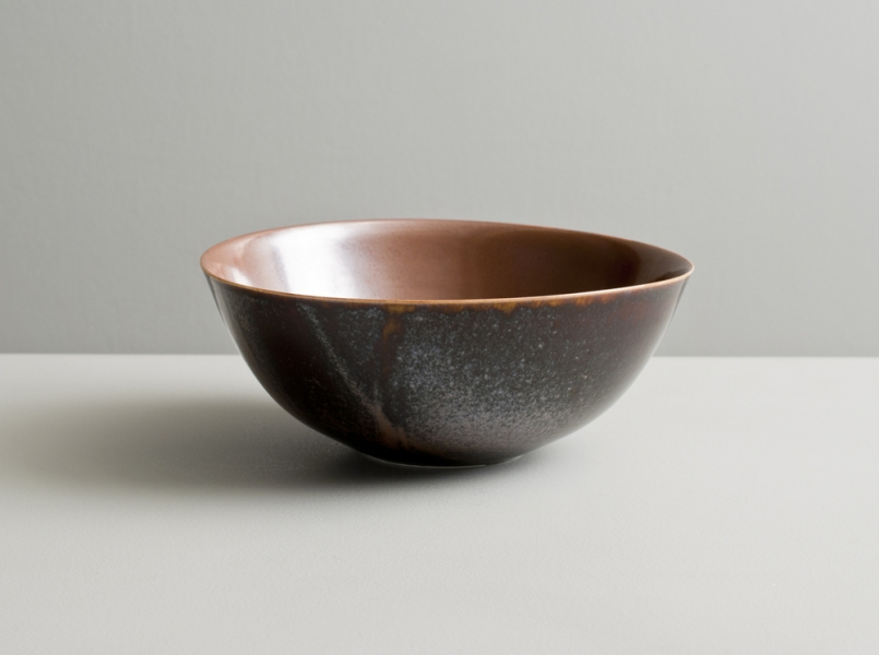2010 Bowl in russet and variegated amber-black glazes