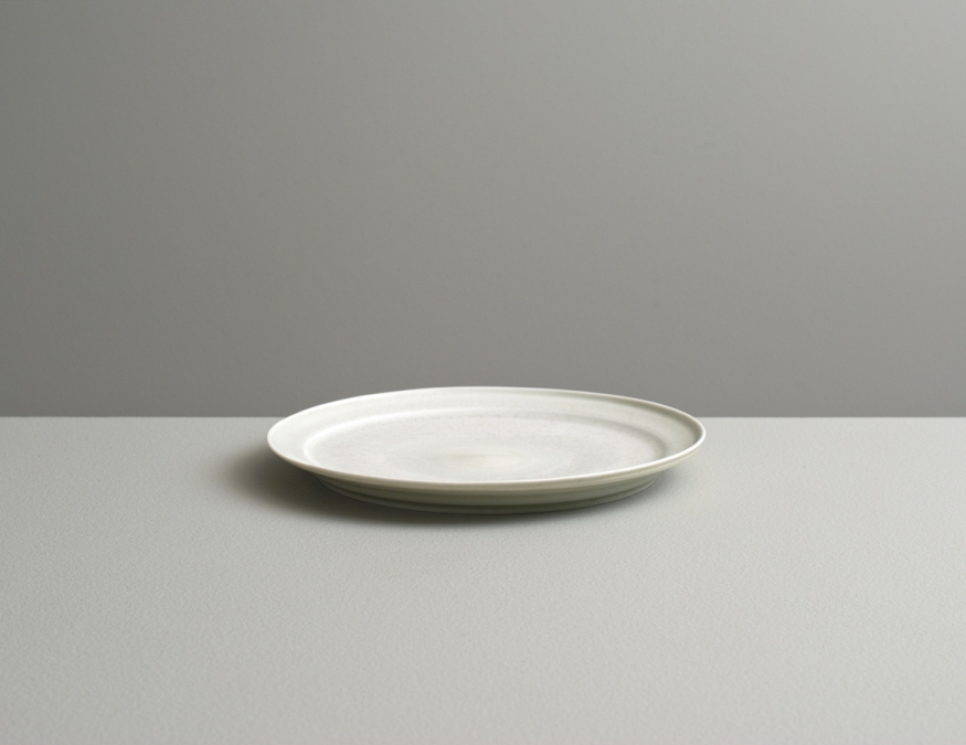 2012 Small plate in ivory-violet and ivory-green glazes (#121078)