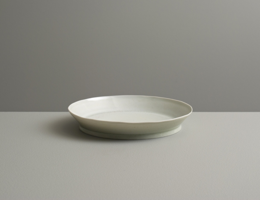 2012 Small plate in ivory-violet and ivory-green glazes (#121079)
