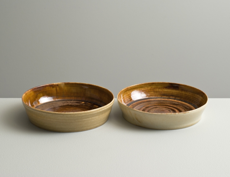 2012 Pair of small plates in running-amber and ivory glazes (#121077)