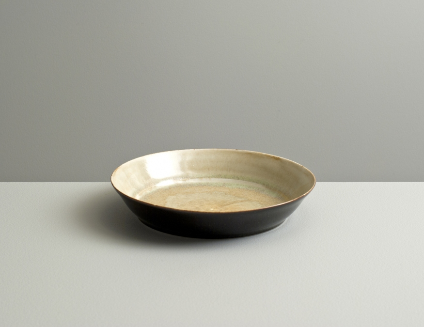2012 Small plate in ivory-green and mirror-black glazes (#121061)