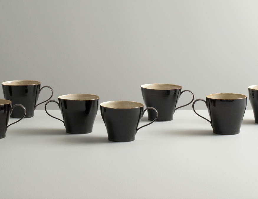 2012 Set of 8 cups in ivory-green and mirror-black glazes (#121027)
