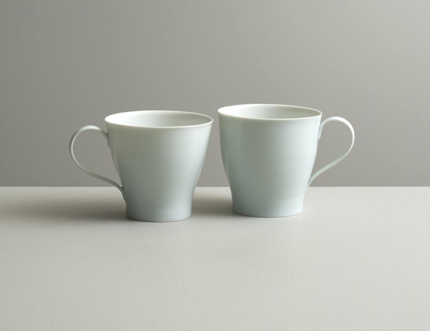 2012 Pair of cups in satin-white and celadon glazes (#121059)