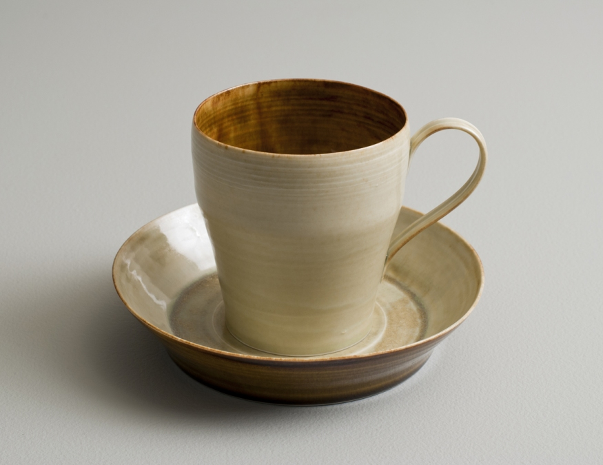 2012 Cup with small plate in running-amber and ivory-green glazes (#121084)