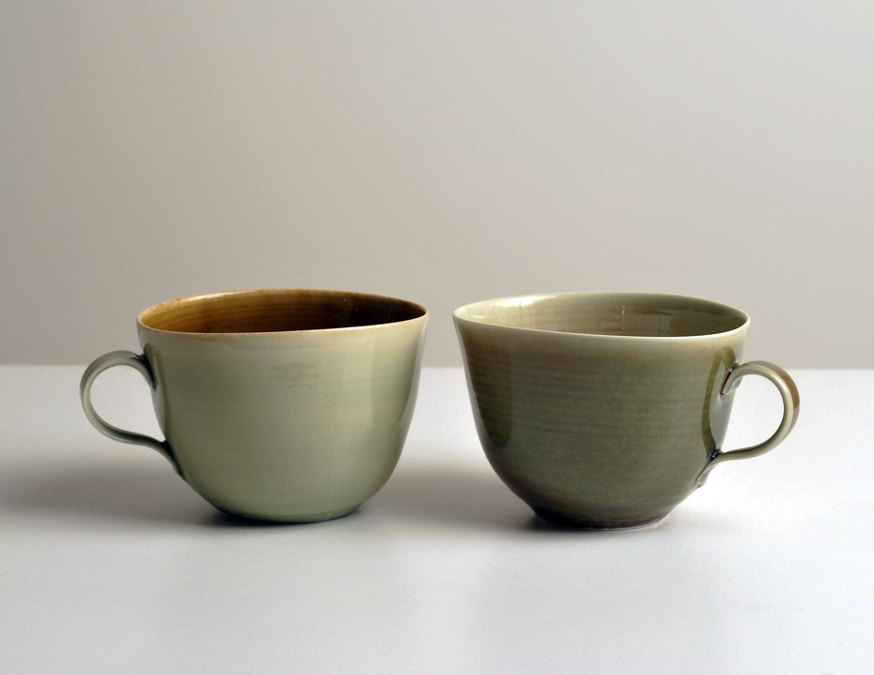 2010 Two cups in amber, jade-green, and moss-green glazes