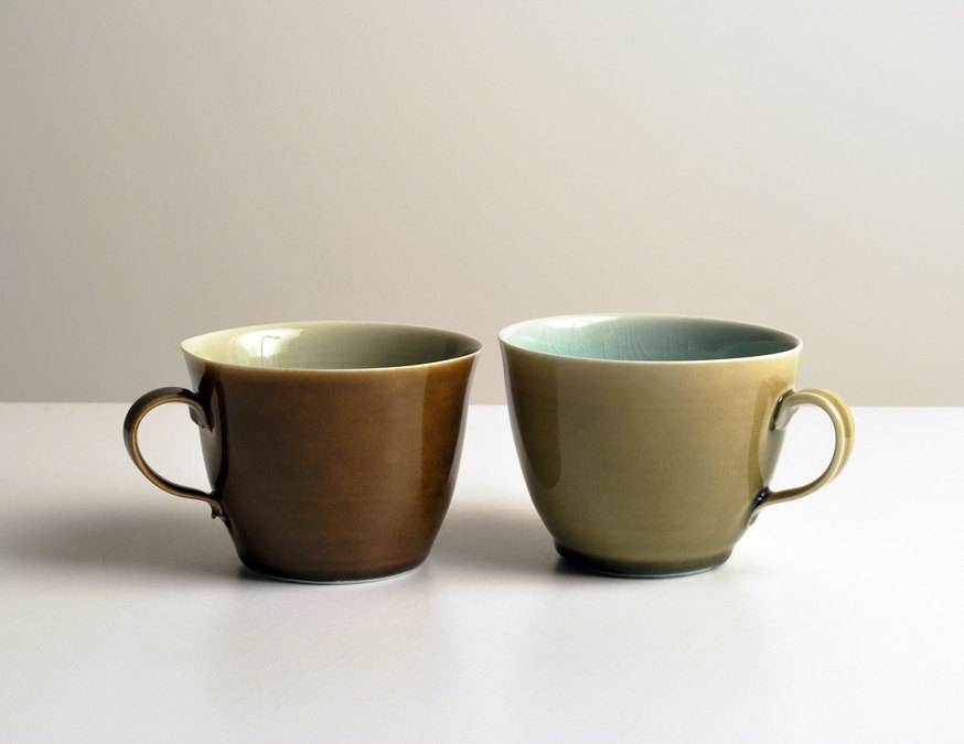 2010 Two cups in jade-green, amber, celadon and gold-green glazes