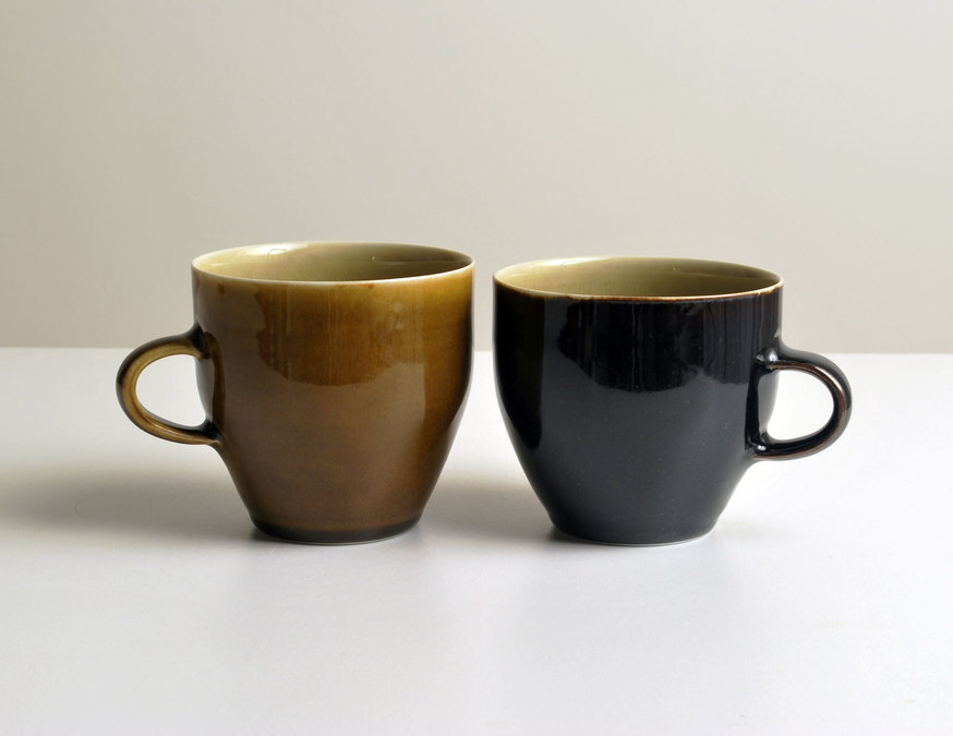 2010 Two cups in golden, amber, and mirror-black glazes