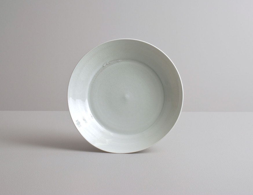 2014 Translucent wavering plate in variegated celadon glaze (#140354)