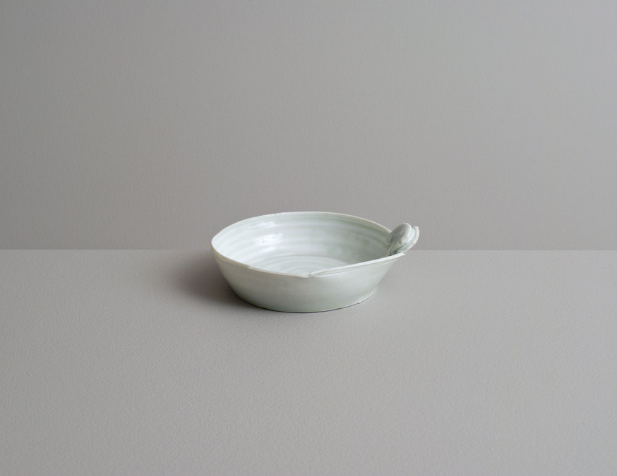 2014 Small translucent plate with handle in mottled celadon glaze (#140323)