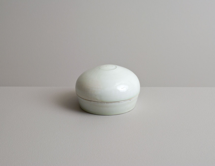 2014 Lidded box in running celadon glazes with cobalt underglaze banding (#140313)