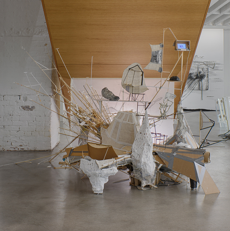 Patte Loper 2014 - 2015 After Lebbeus: A Model For Drawing  Salvaged material, duct tape, latex paint, DVD player, iPod Touch, animated video shown as a loop