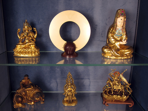 All is Always Now 1950's TV antenna flanked by ancient Buddhas.