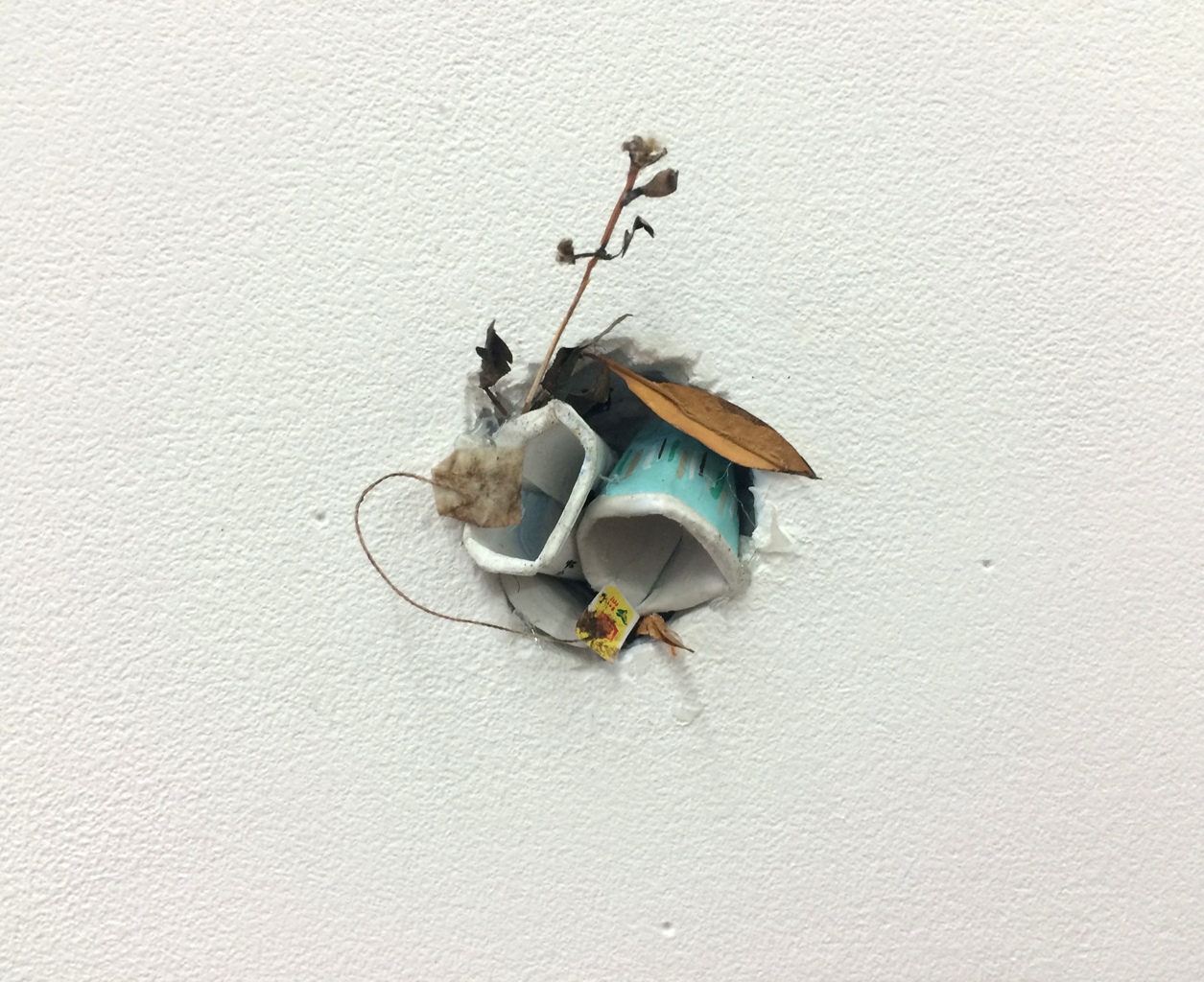 RACHEL GROBSTEIN Miniature Sculpture gouache on cut paper, thread [installed in hole]