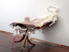Rebecca Ripple work  wood table, bobbin lace, plaster, paint, acrylic, sculpt-a-mold, graphite