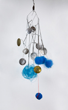 Robin M Jordan Mobiles umbrella detritus, tin can lids, polypropylene, copper rivets, nickel wire, plastic