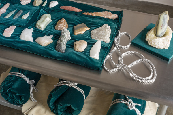 Rose Nestler Stone Age Tool Kit carved stones, velvet, thread, fiberfill, rope, leather, metal table