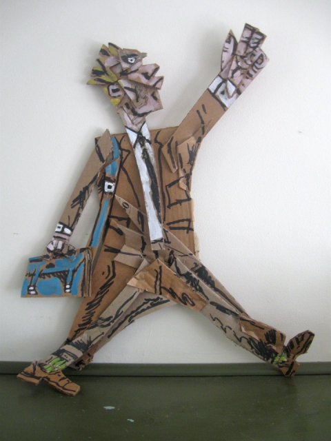 Cardboard, Wood and Stone Walking Man