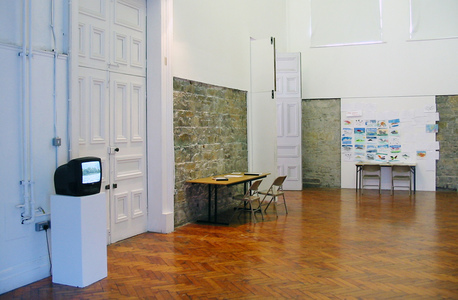 Sarah Iremonger Upside-down Mountains 2003 Wall painting, video, TV monitor, photographs, reproduction prints, photocopied documents, tables, chairs, stencils, pens & paper