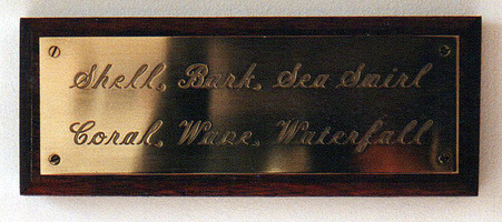 Sarah Iremonger from effect to ideology and back again 2000 Brass and mahogany plaque