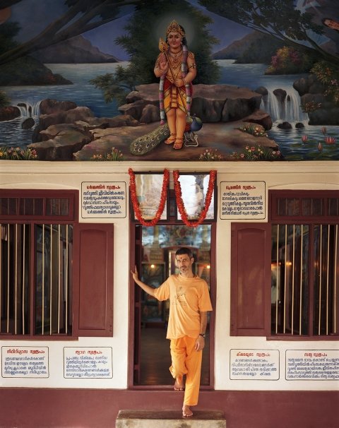 <b>The Searchers (Part II)</b> White Zimbabwean Swami with Krishna mural, at the Sivananda Yoga Ashram (Kerala, India)
