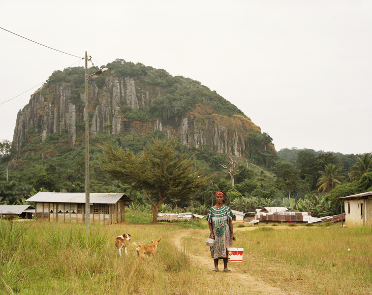 <b>Republic of Dust</b> Woman with buckets near the Equatorial Guinea border