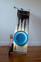 Sean Naftel  Wood, ink, fluorescent light and fixture, spray paint, steel, zip ties , rope, found wheel and handles<br/>