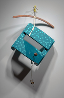 Sean Naftel  Plastic hook, wooden hanger, cotton strap, wood, paint, carabiner, wire, miniature chair and street lamp <br/>